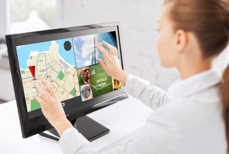 touch screen: business, people, navigation and technology concept - woman with gps navigator map on computer touchscreen in office