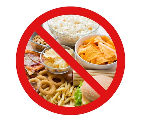 fattening: fast food, low carb diet, fattening and unhealthy eating concept -close up of fast food snacks and cola drink behind no symbol or circle-backslash prohibition sign Stock Photo