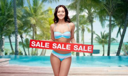 a896be4a77b #53432794 - 人、夏、旅行および観光事業のコンセプト - スイミング プール、ヤシの木の背景を持つビーチ署名レッド販売とビキニ水着 で幸せな若い女