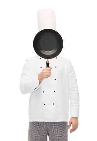cooking, profession and people concept - male chef cook covering face or hiding behind frying pan Stock Photo