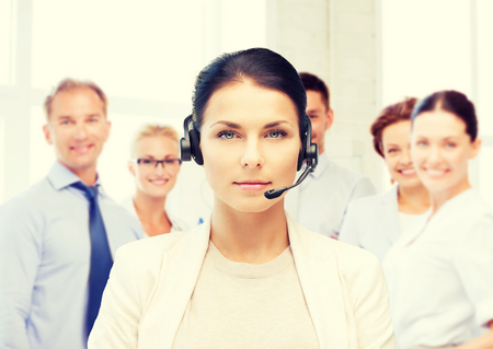 tech support: business and call center concept - helpline operator with headphones in call centre