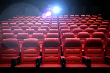 theatre performance: entertainment and leisure concept - movie theater or cinema empty auditorium with red seats Stock Photo