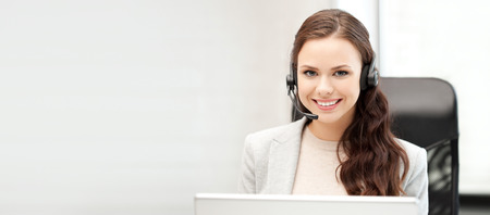 computer operator: office and technology concept - picture of helpline operator with laptop computer