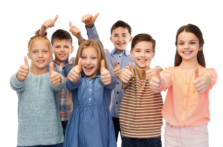 pre approval: childhood, fashion, gesture and people concept - happy smiling children showing thumbs up