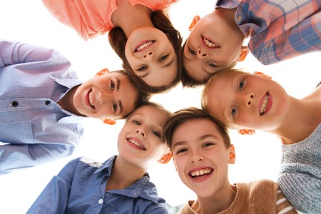 childhood, fashion, friendship and people concept - happy smiling children faces Stock Photo