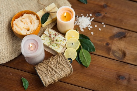 natural therapy: beauty, spa, therapy, natural cosmetics and wellness concept - close up of body care cosmetic products on wood