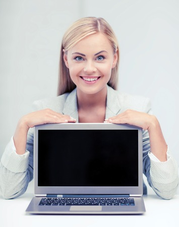 university application: education,business, technology and internet concept - smiling woman with laptop pc Stock Photo