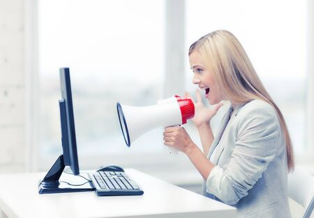 strict: picture of strict businesswoman shouting in megaphone Stock Photo