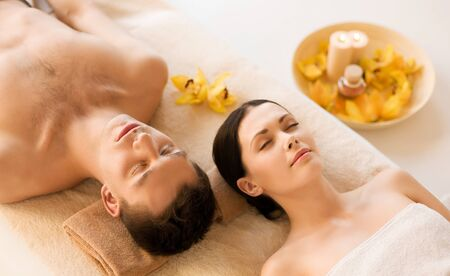 aromatherapy: picture of couple in spa salon lying on the massage desks