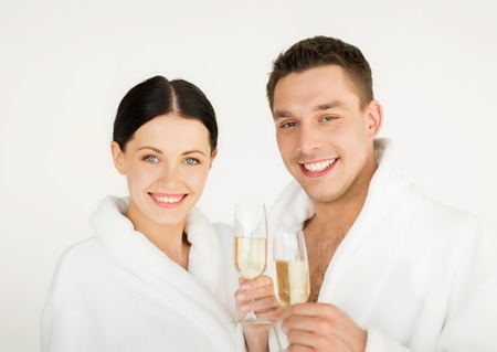 bathrobes: picture of couple in spa salon in white bathrobes with champagne