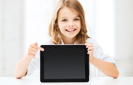 internet school: education, school, technology and internet concept - little student girl with tablet pc at school