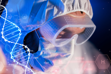 clinical: science, chemistry, biology, medicine and people concept - close up of scientist face in goggles and protective mask at chemical laboratory over hydrogen chemical formula and dna molecule structure Stock Photo