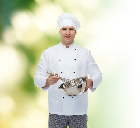 whisk: cooking, profession and people concept - happy male chef cook holding bowl and whipping something with whisk over green background