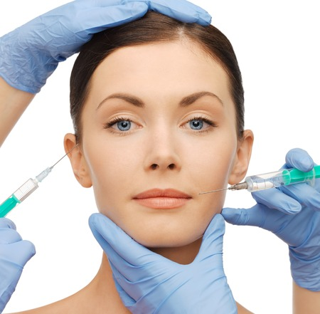 augmentation: health and beauty concept - woman getting dermall fillers injection
