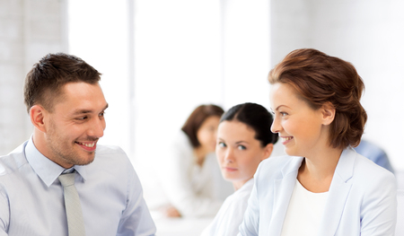 colleagues: picture of business colleagues talking in office Stock Photo