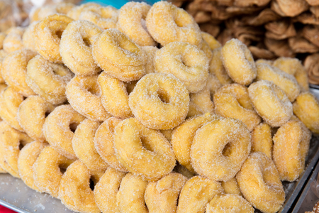 sugared: cooking, asian kitchen, sale and food concept - sugared donuts at asian street market