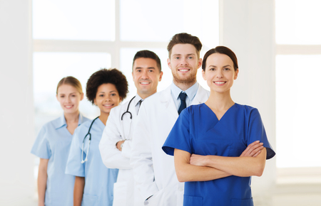 co workers: hospital, profession, people and medicine concept - group of happy doctors at hospital