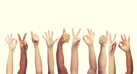 human hands: gesture and body parts concept - human hands showing thumbs up, ok and peace signs