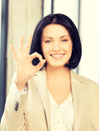 yuppie: bright picture of young woman showing ok sign