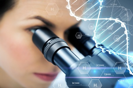 biotech: science, chemistry, technology, biology and people concept - close up of female scientist looking to microscope in clinical laboratory over hydrogen chemical formula and dna molecule structure