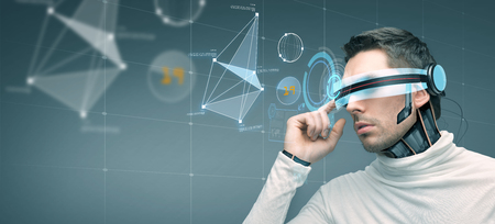 high tech device: people, technology, future and progress - man with futuristic 3d glasses and microchip implant or sensors over gray background with virtual screen Stock Photo