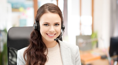 conference call: people, online service, communication and technology concept - smiling female helpline operator with headset over office background