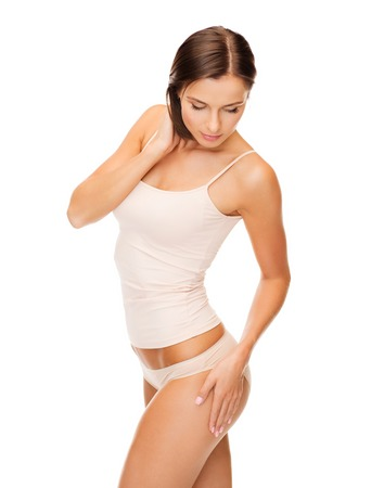 body slim: health and beauty - woman in cotton underwear showing slimming concept Stock Photo