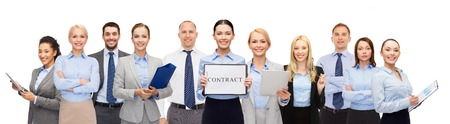work  office: business, people, partnership, work and office concept - group of happy businesspeople holding contract