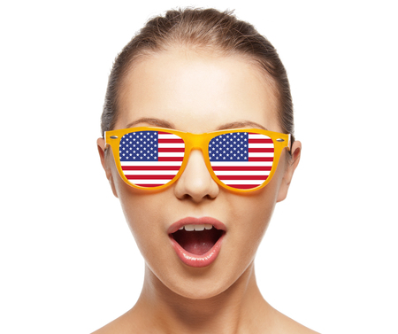 teenage girl happy: people, patriotism, national pride and independence day concept - happy teenage girl in shades with american flag Stock Photo