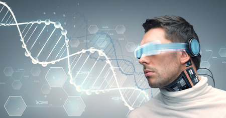 molecules: people, technology, future and progress - man with futuristic glasses and microchip implant or sensors over gray background and dna molecules with chemical formulas