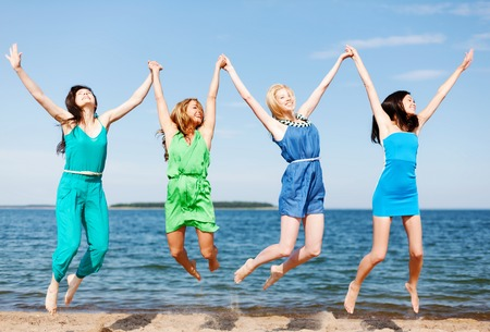 bachelorette party: summer holidays and vacation - girls jumping on the beach