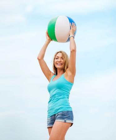 beach ball girl: summer holidays, vacation and beach activities - girl playing ball on the beach
