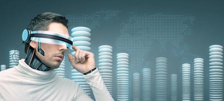advances: people, technology, future and progress - man with futuristic 3d glasses and microchip implant or sensors over blue background with world map and bit coin towers Stock Photo
