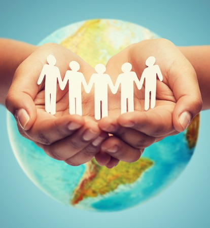 hands holding globe: people, geography, population and peace concept - close up of human hands with earth globe showing american continent over blue background
