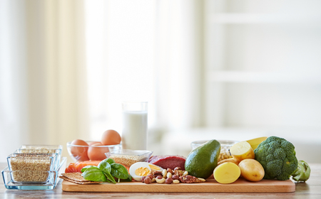 healthy grains: balanced diet, cooking, culinary and food concept - close up of vegetables, fruits and meat on wooden table