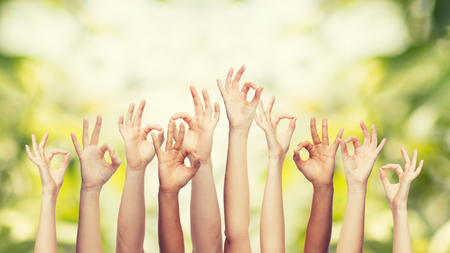 body parts: gesture and body parts concept - human hands showing ok sign Stock Photo