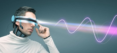 electromagnetic: people, technology, future and progress - man in futuristic 3d glasses and microchip implant or sensors over gray background with laser light and electromagnetic waves Stock Photo