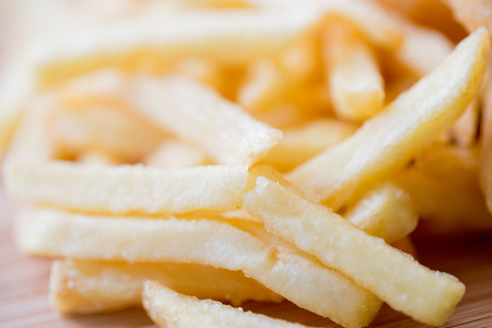 junkfood: junk-food, fast food and eating concept - close up of french fries on table