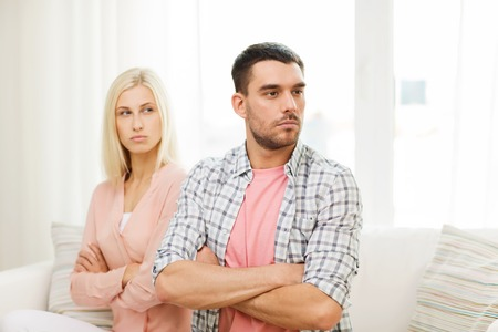 family fight: people, relationship difficulties, conflict and family concept - unhappy couple having argument at home Stock Photo