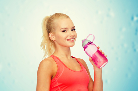 water bottles: sport, exercise and healthcare - sporty woman with water bottle