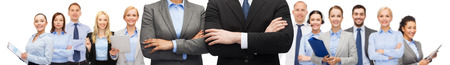 arms crossed: business, people, cooperation and education concept - close up of businesswoman and businessman with crossed arms over office team background Stock Photo