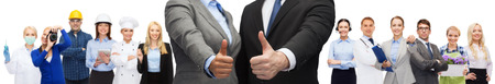 business, people, cooperation, success and gesture concept - businessman and businesswoman showing thumbs up over representatives of different professions background Foto de archivo