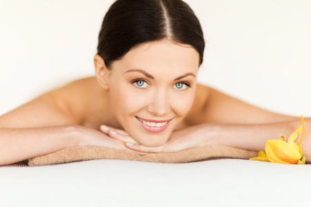 beauty concept: picture of woman in spa salon lying on the massage desk