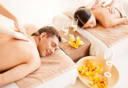 all smiles: picture of couple in spa salon getting massage