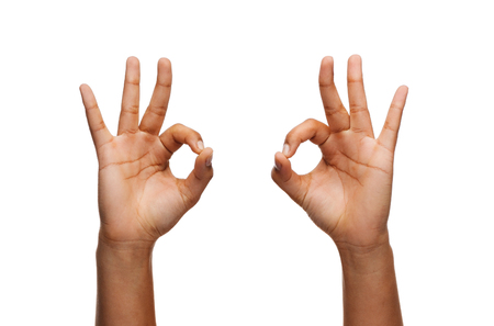 body parts: gesture and body parts concept - woman hands showing ok sign Stock Photo