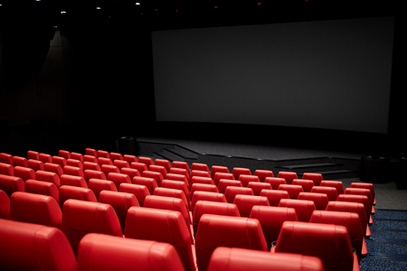 entertainment and leisure concept - movie theater or cinema empty auditorium with red seats Stock Photo