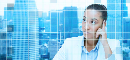 analytical: business and people concept - african american businesswoman looking up and thinking over city and blue grid background