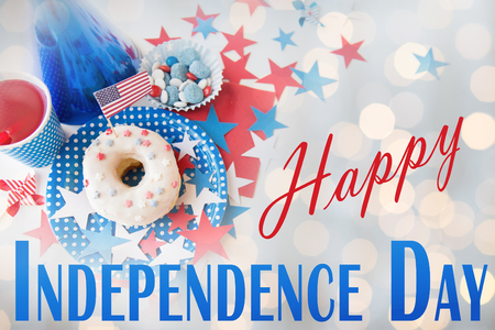 food state: happy american independence day, celebration, patriotism and holidays concept - close up of donut with juice drink and candies in disposable tableware at 4th july party from top