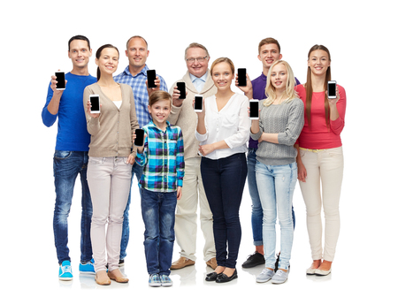 mobile phones: family, technology, generation and people concept - group of smiling men, women and boy smartphones Stock Photo