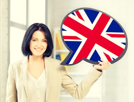 british english: education, foreign language, english, people and communication concept - smiling woman holding text bubble of british flag Stock Photo